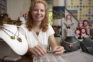 Jeaneane McKinnon, an artisan at Cave Arts in Abingdon, poses with her hand made jewelry. CameronDavidson@CameronDavidson.com