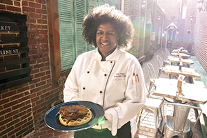 Chef Joy Crump with her Chicken & Waffles